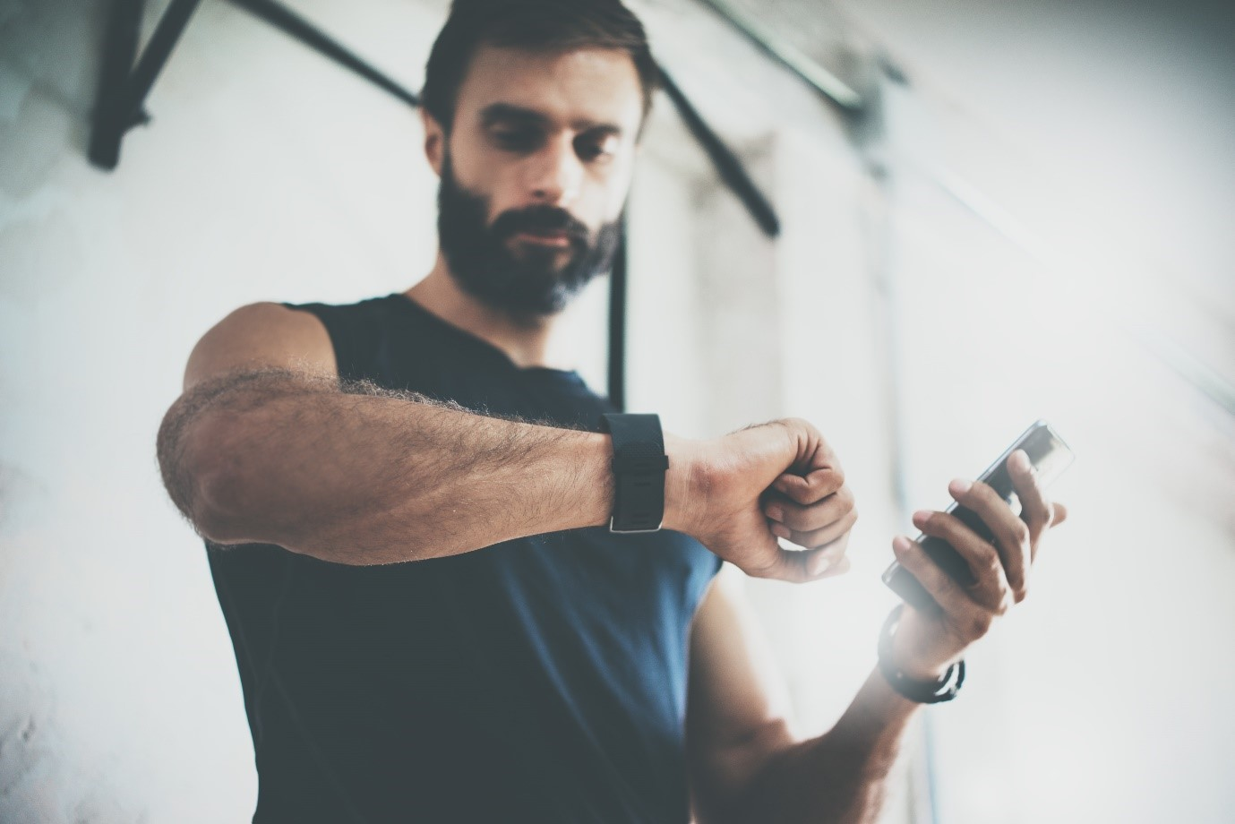 Fitness trainer checks results on watch