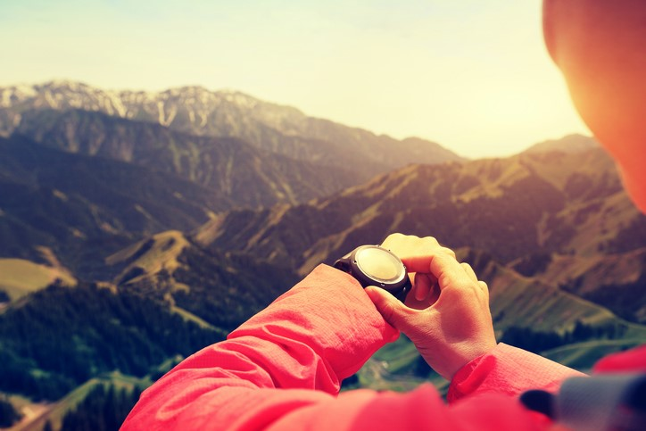 woman-hiker-checking-watch