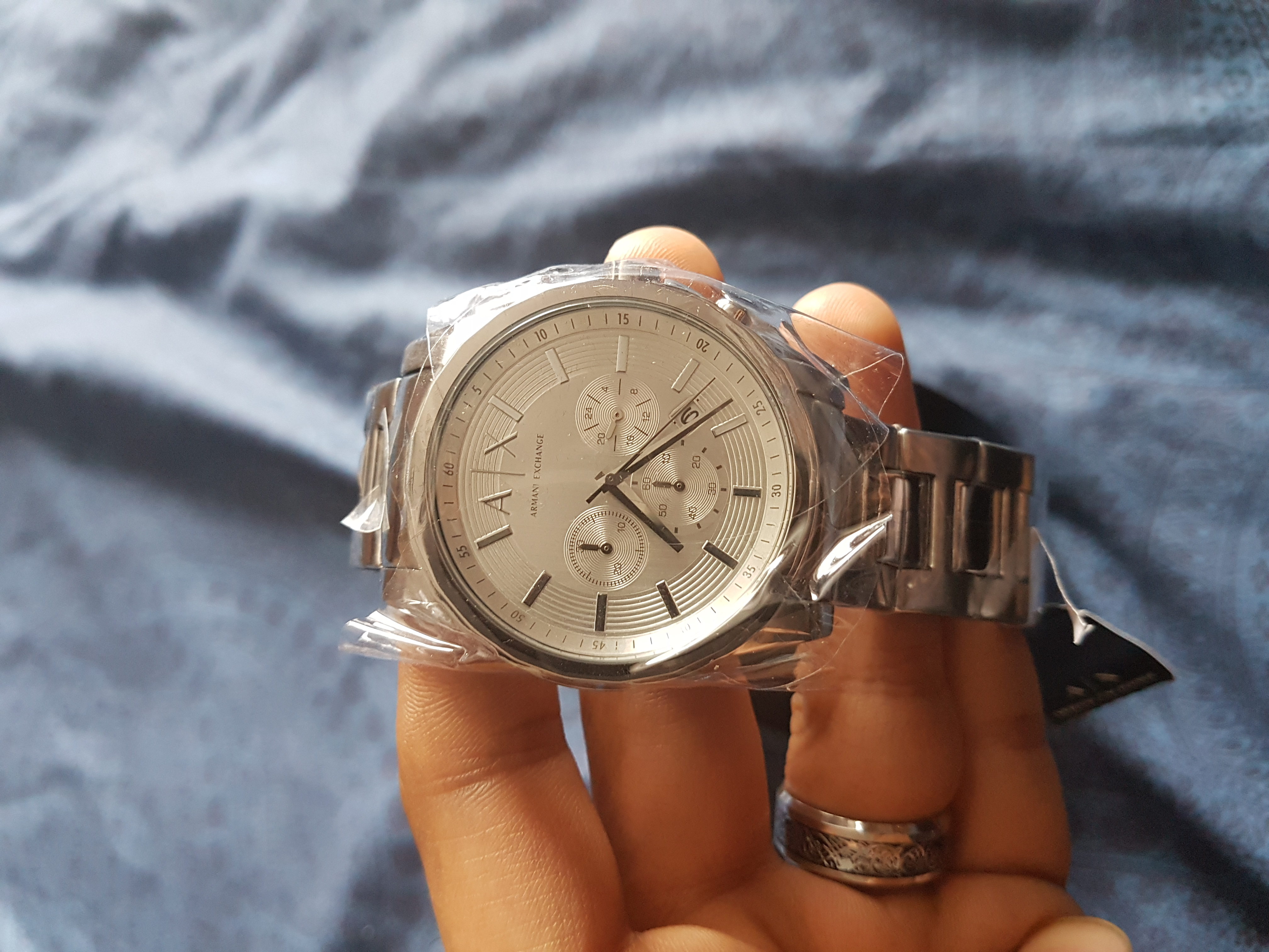 e8e9b61979598 I love this watch. excellent finishing of silver color. this is third  addition in my Armani exchange collection and I love it most.  choronographic dials ...
