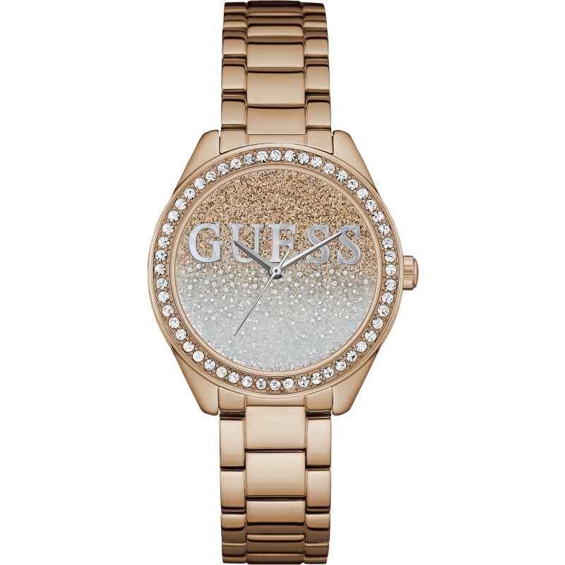 GUESS Ladies rose gold watch with silver and white glitter logo dial.