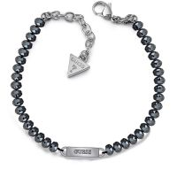 GUESS midnight blue bead bracelet with rhodium plated logo plaque.