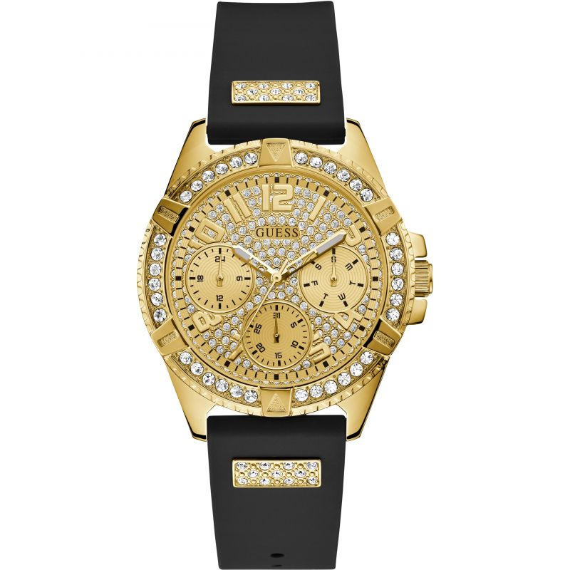 GUESS Ladies gold watch with crystals, champagne glitz multifunction dial and black silicone strap.