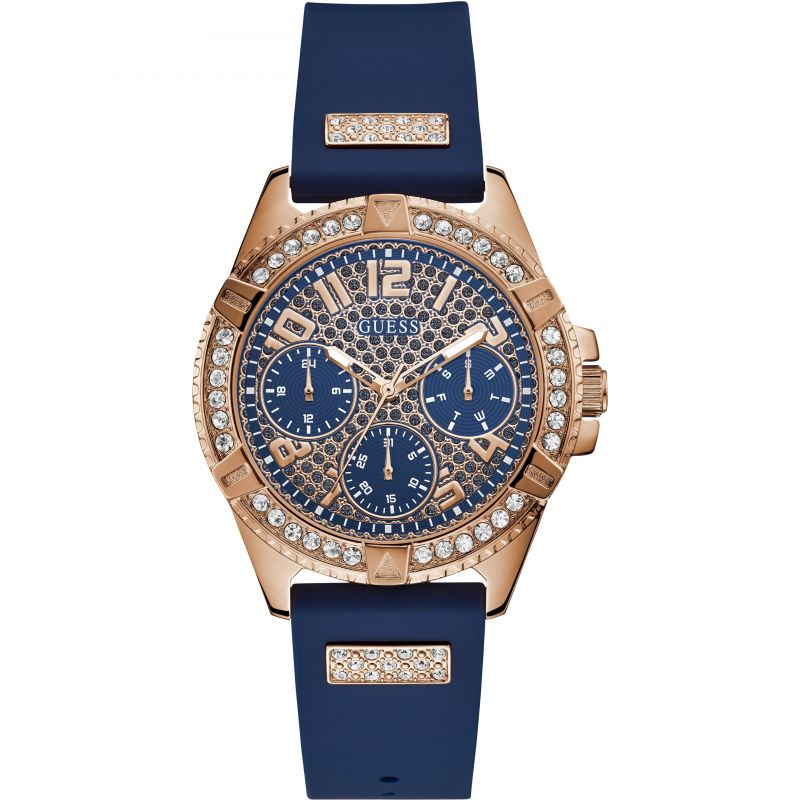 GUESS Ladies rose gold watch with blue strap and glitz dial.