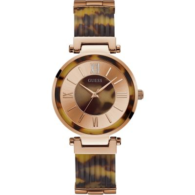 GUESS Ladies rose watch with tortoiseshell trim and bangle bracelet.