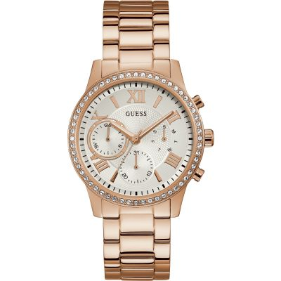 GUESS Ladies rose watch with crystals and white dial.