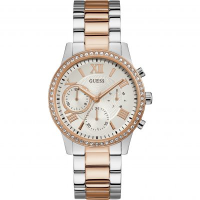 GUESS Ladies silver and rose gold watch with crystals and white multifunction dial.